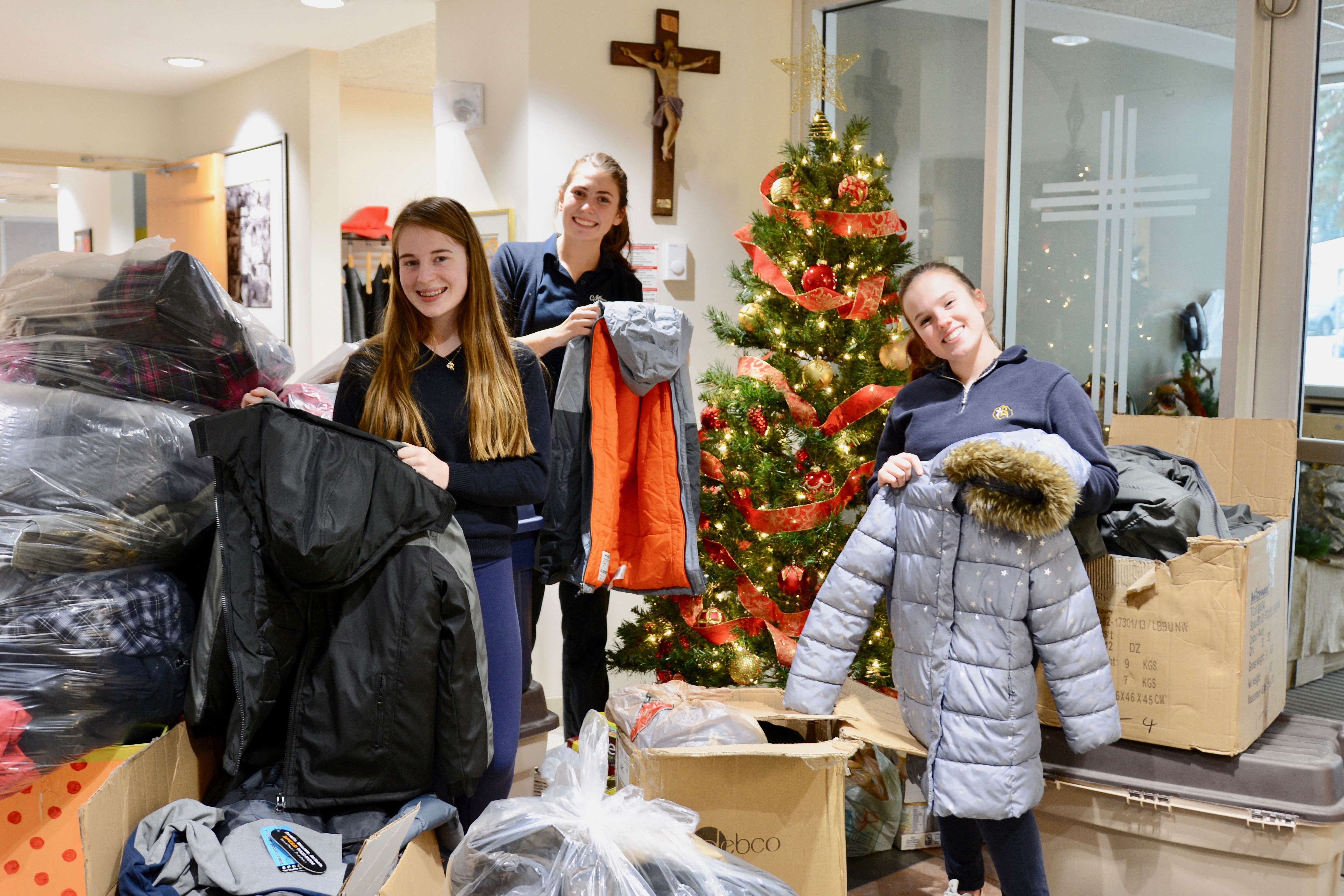 Student Senate members Kira Gouchie and Megan Santi along with fellow student Kendra Brown stand proudly with coat and winter donations. The donations will help families in need this holiday season!