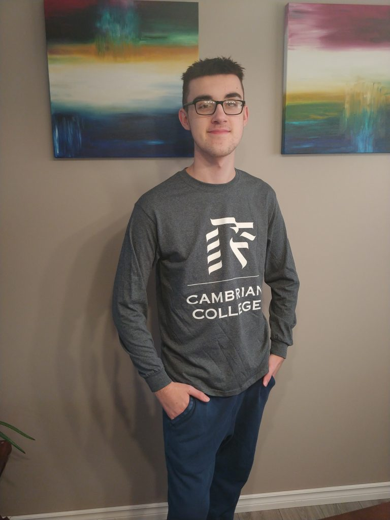 Isaac in his Cambrian College shirt